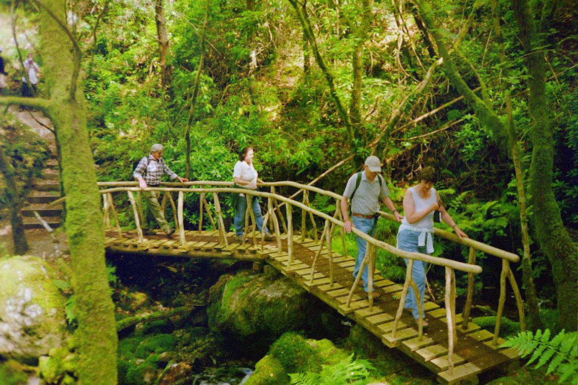 People crossing a bridge on The Gentleman's Walk