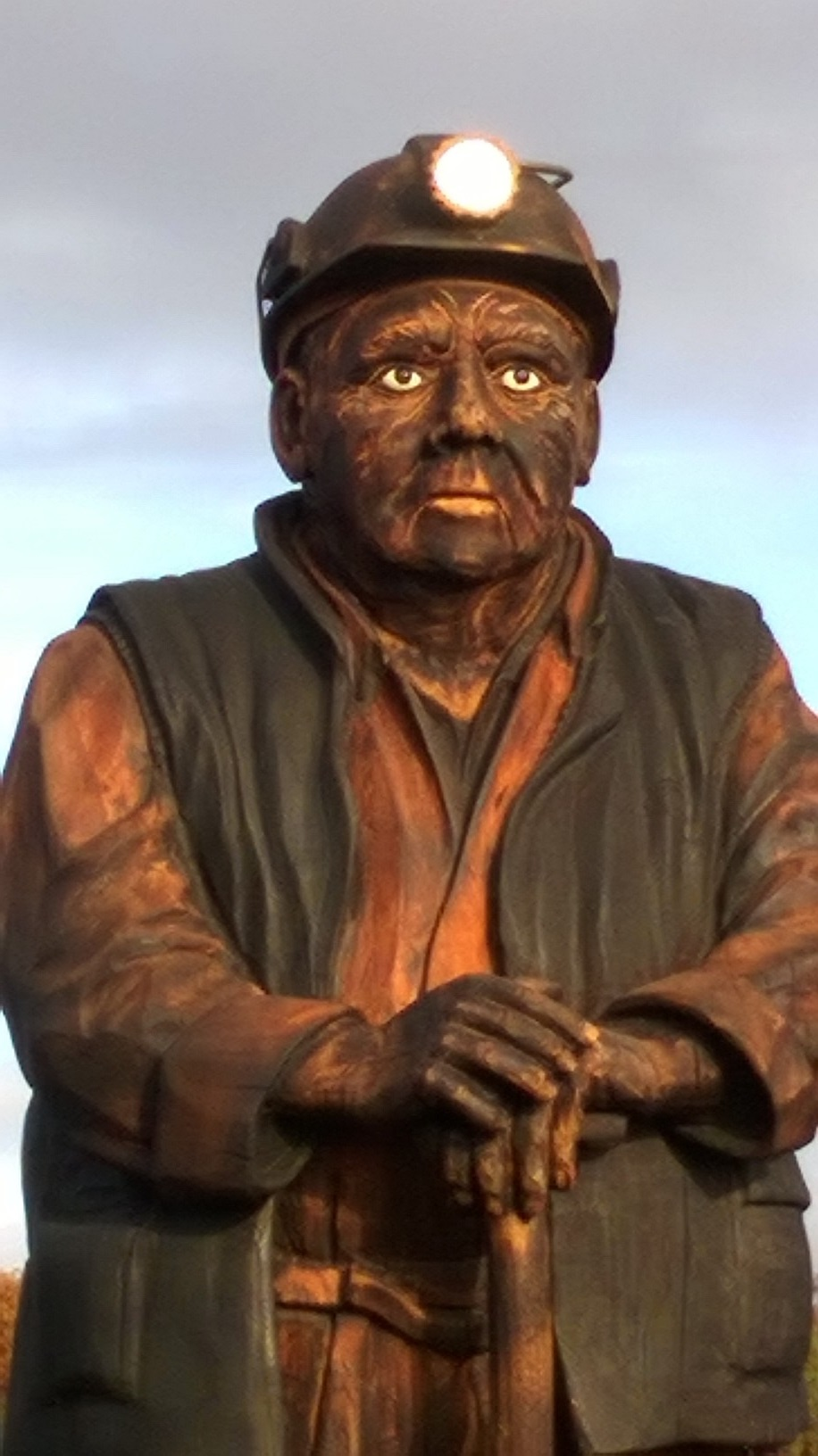 The Keeper of the Collieries is a nine foot tall, one and a half tonnes wooden statue at the Spirit of Llynfi Woodland site