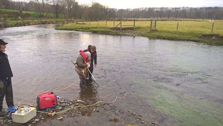 NRW staff testing and cleaning the River Teifi in Ceredigion