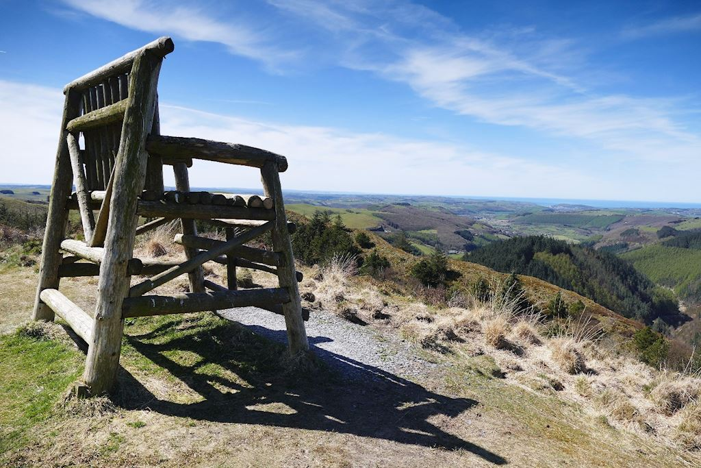 A big wooden chair overlooking the mountain