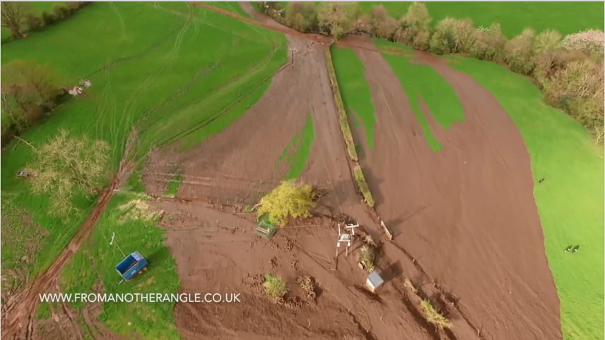 Image of slurry going downhill on a farm