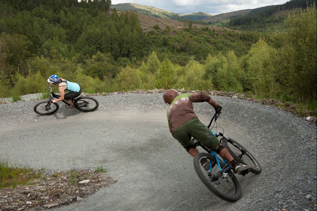 Two people on a cycling trail at Coed y Brenin Forest Park