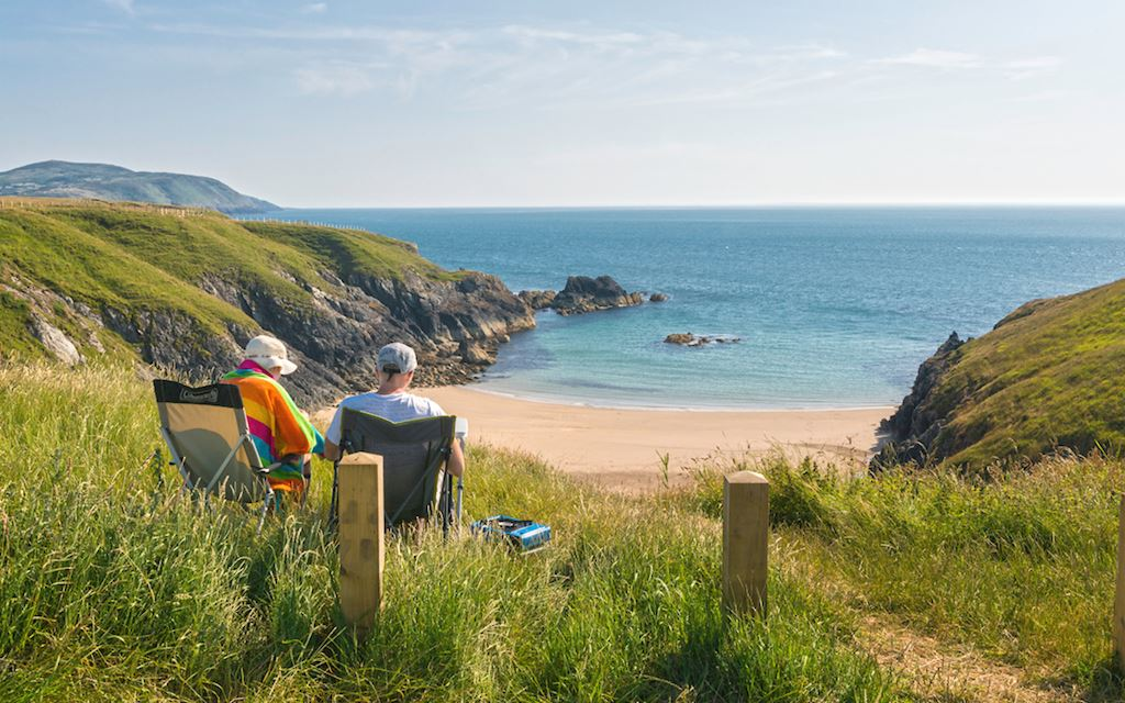 Couple looking over Porth Iago © Visit Wales 2014