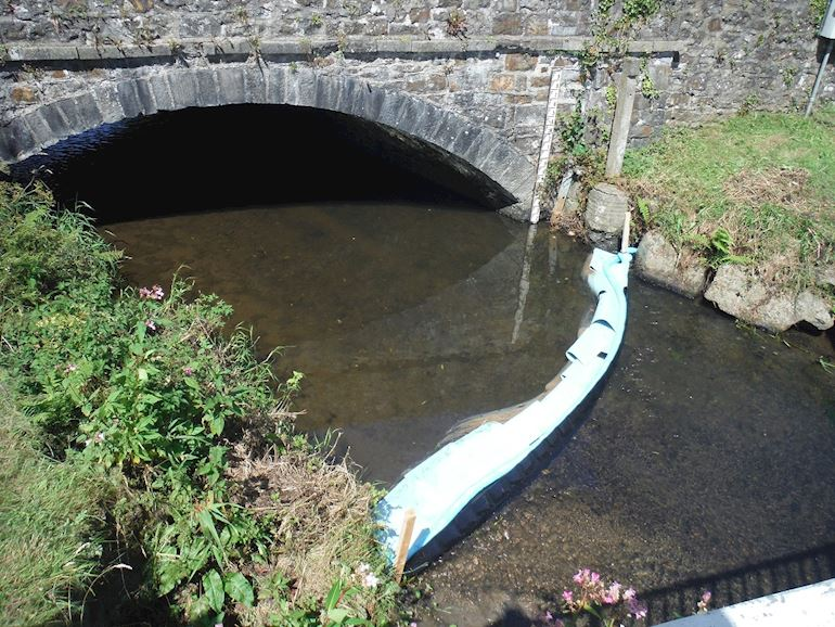 Image of a boom that has been deployed on the Tawelon Brook, near Johnstown in Carmarthenshire